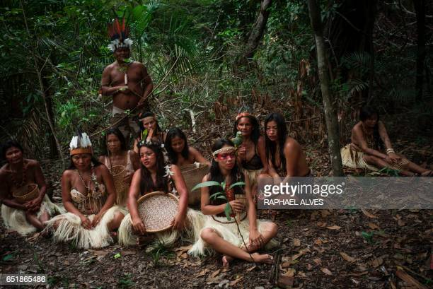 Indigenous people gather for a photo in a forested area in the Parque das Tribos community in the rural area of Manaus Amazonas state in northern...