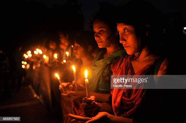 Indigenous people light candles at Central Shahid Minar in Dhaka to celebrate the International Day of the World's Indigenous People 2014 The...