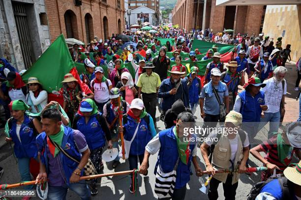 Indigenous people march against Colombian President Ivan Duque in Cali, Colombia, on December 4, 2019. - Protests in Colombia, which are entering the...