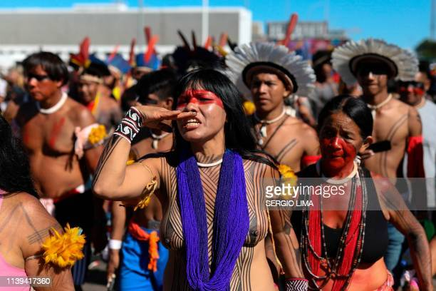 Indigenous people march at the Esplanade of the Ministries on the last day of a protest camp in Brasilia on April 26 2019 Approximately 4000...