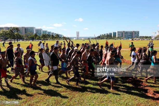 TOPSHOT Indigenous people march at the Esplanade of the Ministries on the last day of a protest camp in Brasilia on April 26 2019 Approximately 4000...