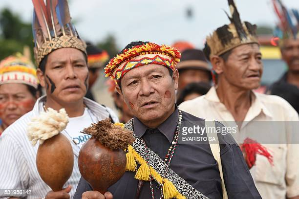 Indigenous people of the GuaraniKaiowa tribe protest on May 17 2016 in front of the Planalto Palace in Brasilia in demand of the demarcation of their...