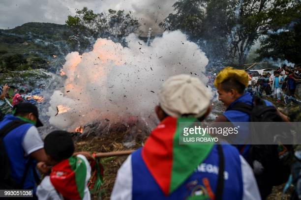 TOPSHOT Indigenous people of the Nasa ethnic group destroy weapons uniforms and explosives seized from ELN guerrillas on July 6 in Corinto Cauca...