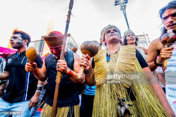 Indigenous people of various ethnic groups protest calling for demarcation of lands during the closing of the 'Red January Indigenous Blood' in...