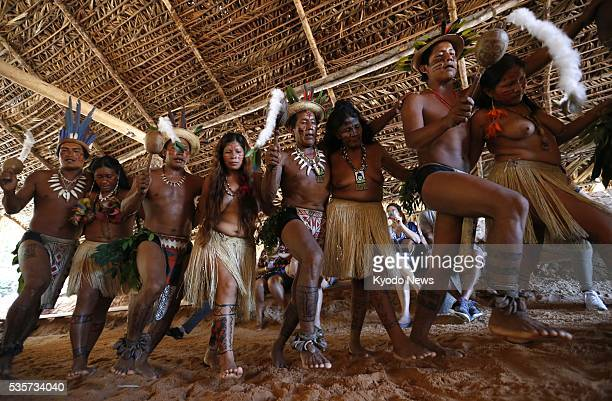 Indigenous people perform a traditional dance for tourists near Manaus northern Brazil on May 6 2016