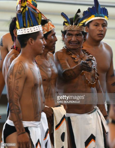Indigenous people wait for the arrival of Pope Francis who is to meet with representatives of indigenous communities of the Amazon basin from Peru...