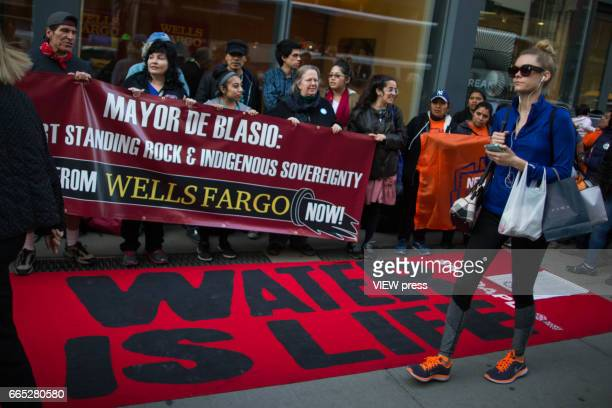 Indigenous peoples and activists begin the overnight camp out in front of the branch on April 5 2017 in Soho New York City Activists are looking to...