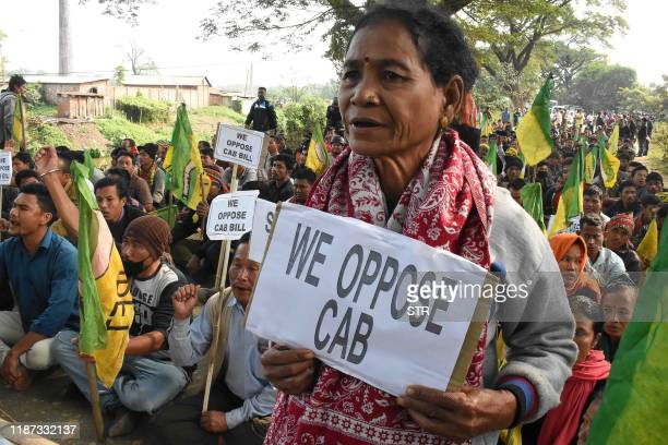 Indigenous People's Front of Tripura hold placards as they protest against the government's Citizenship Amendment Bill in Tripura on December 9 2019...