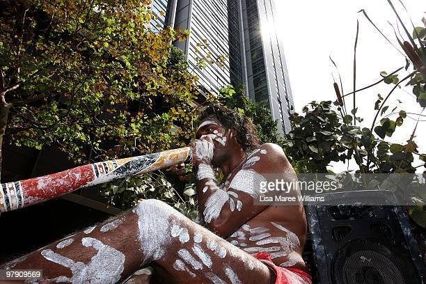 A indigenous performer plays the didgeridoo during the annual St Patrick's Day parade in Sydney's CBD on March 21 2010 in Sydney Australia The...
