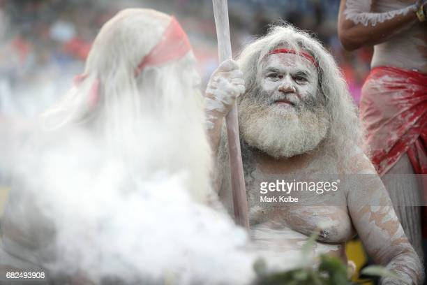 Indigenous performers prepares for a smoking ceremony to commemorate Indigenous Round ahead of the round 10 NRL match between the Penrith Panthers...