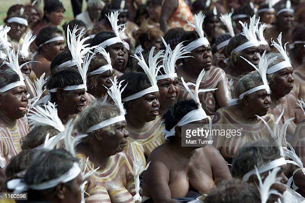 Indigenous performers sit together before the opening of the Yeperenye Federation Festival September 8 2001 in Alice Springs Central Australia The...