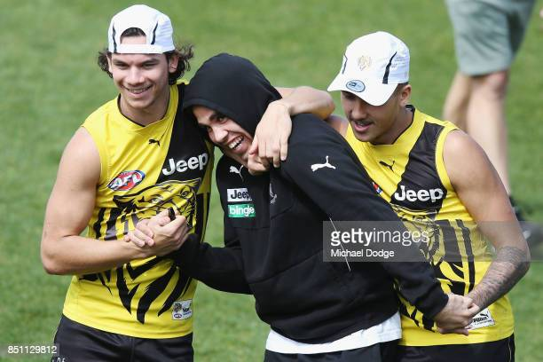 Indigenous players Daniel Rioli Tyson Stengle and Shai Bolton leave the field during a Richmond Tigers AFL training session at Punt Road Oval on...