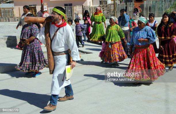 Indigenous Raramuri or Tarahumara ethnic group members celebrate Holy Week with their typical costumes dancing the Dance of the Pintos or Dance of...