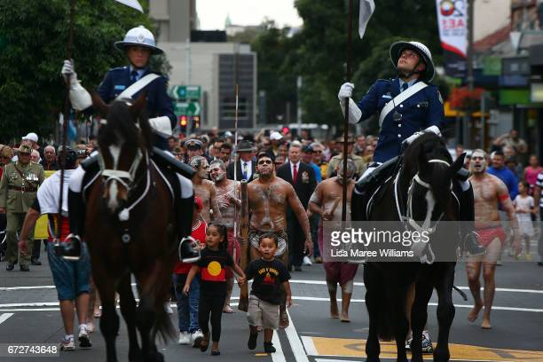 Indigenous service people and families participate in a ANZAC march towards Redfern Park during a on April 25 2017 in Sydney Australia The annual...