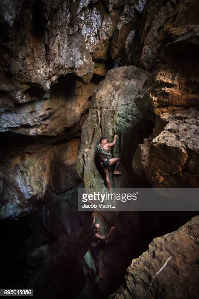 Indigenous Tagbanua men climbing caves to collect bird nests.