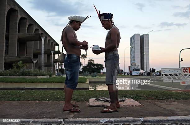 Indigenous tribe members stand while attending a demonstration against the impeachment outside the National Congress building where a special session...