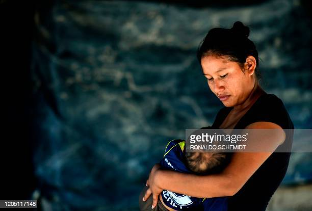 Indigenous Wichi woman Rosalia Gomez breastfeeds her son at their house in the indigenous community of Santa Victoria Este Salta Province Argentina...