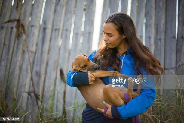 Indigenous woman plays with her dog