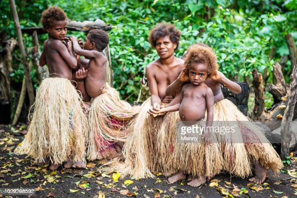 indigenous women and children tanna island rainforest tribe community vanuatu - polynesian culture stock photos and pictures