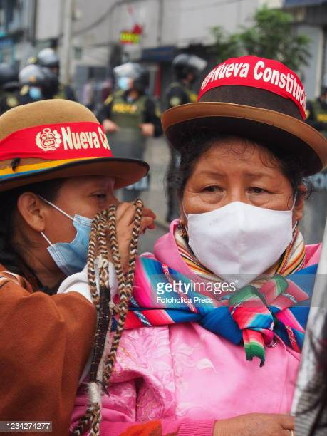 Indigenous women demonstrating when on the day of Pedro Castillo's presidential inauguration his supporters take to the streets to demand a new...