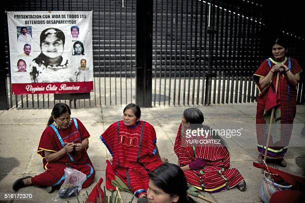 Indigenous women gather in front the Mexican Senate building after a march to protest against forced disappearance in Mexico City on March 17, 2016....