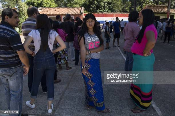 Indigenous women members of Maka tribe wait to vote at a polling station in Mariano Roque Alonso outskirts of Asuncion on April 22 during Paraguay's...
