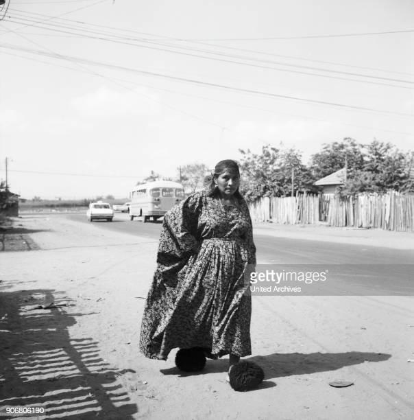 Indigenous women of Goajira walks down the street near or in Maracaibo Venezuela 1966