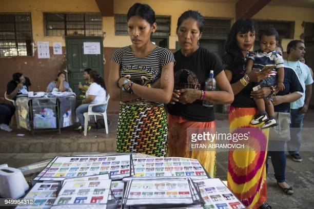 Indigenous women of the Maka tribe prepare to vote at a polling station in Mariano Roque Alonso outskirts of Asuncion on April 22 during Paraguay's...