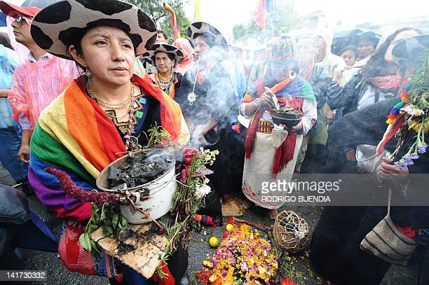 Indigenous women perform a ritual during a march to protest against the policies of President Rafael Correa they say will result in more mining in...