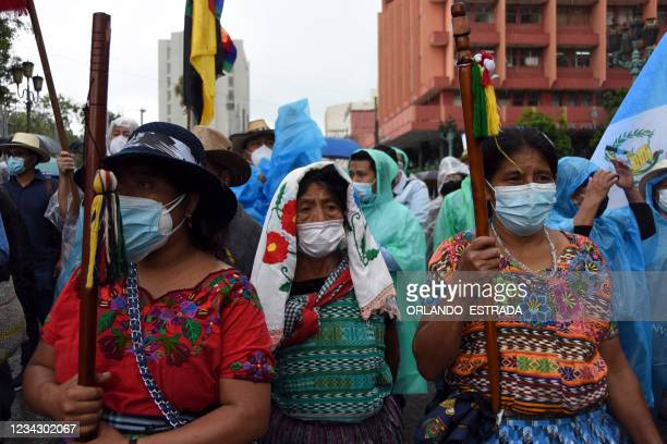Indigenous women take part in a protest demanding the resignation of Guatemalan President Alejandro Giammattei and Guatemala's Attorney General...