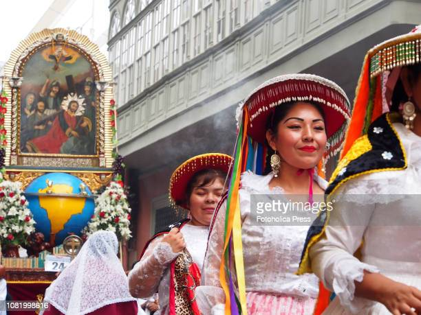 Indigenous women wearing andean typical costume when hundreds of Quechuaspeaking Indigenous people devotees of San Sebastian carry on a religious...