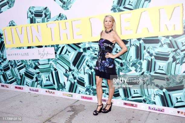 Indira Cesarine poses in front of the Maybelline New York Mural during NYFW The Shows at Spring Studios on September 11 2019 in New York City