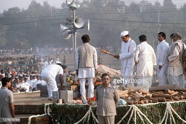 Indira Gandhi's son Rajiv lights the pyre of the slain Indian Prime Minister Indira Gandhi during the cremation ceremony on November 03 1984 in...