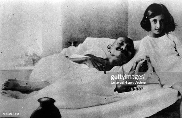 Indira Priyadarshini Gandhi third Prime Minister of India as a girl next to Mahatma Gandhi the Indian leader who was on hunger strike 1930
