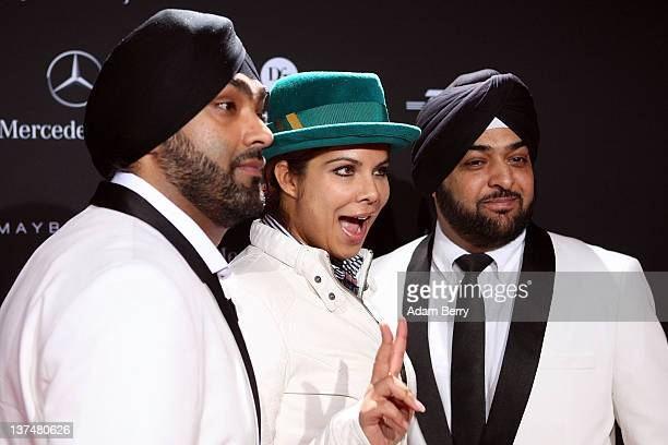 Indira Weiss and the Bhangra Brothers arrive at the Stephan Pelger Autumn/Winter 2012 fashion show during MercedesBenz Fashion Week Berlin at...