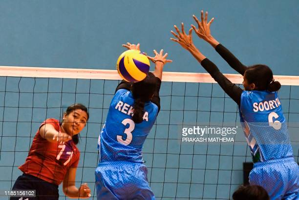 Indis's Rekha Sreesailam tries to block against Nepal's Pratibha Mali during women's volleyball match between India and Nepal at the 13th South Asian...