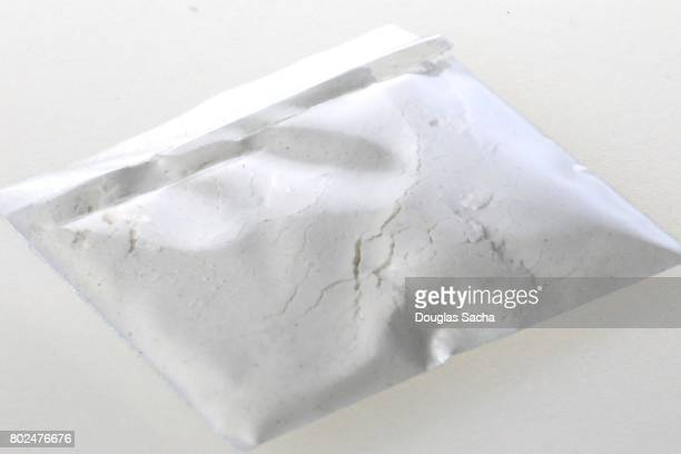 Individual bag of illegal drug on a white background
