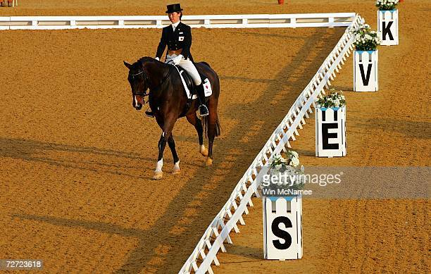Individual Equestrian Dressage silver medal winner Yukiko Noge of Japan rides atop Lanchester Kouko during the final stage of competition at the 15th...
