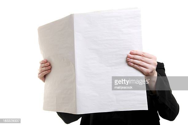 Individual holding blank newspaper in front of their face