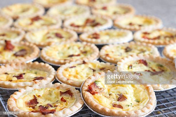 Individual jam tart size quiches.
