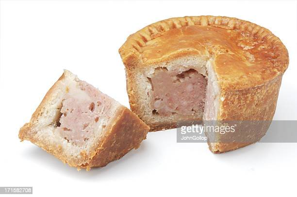 Individual pork pie against white background