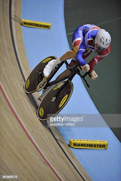 Individual pursuit world and olympic champion, Britain's Bradley Wiggins, competes against Netherlands' Jenning Huizenga during the Men's individual...