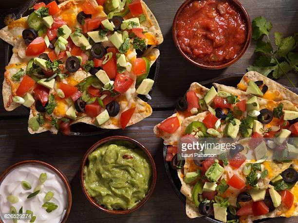 individual skillet nachos - nachos stock photos and pictures