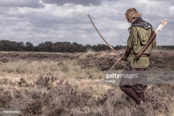a individual viking archer warrior in the countryside - northern european stock pictures, royalty-free photos & images