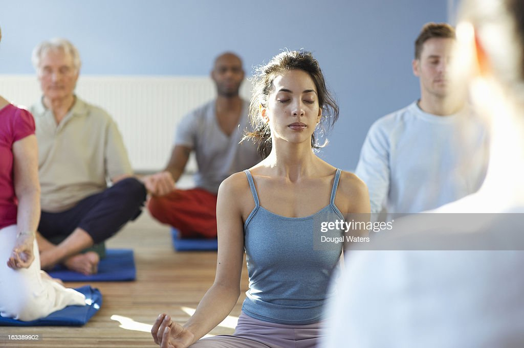 Individual within meditation class : Stock Photo