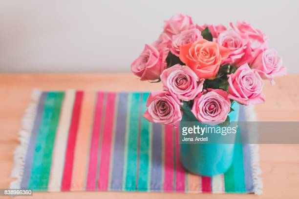 individuality concept roses in a vase - jena rose stock pictures, royalty-free photos & images