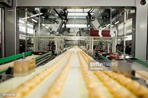 Individually wrapped chocolate covered hazelnut sweets move along a conveyor belt on the production line at the Roshen Confectionary Corp factory in...