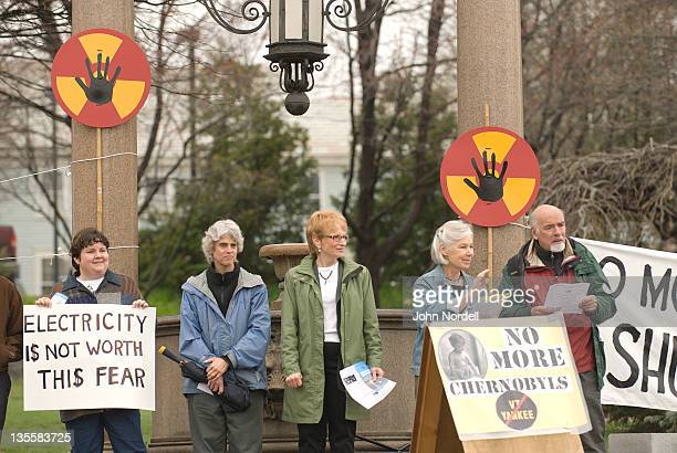 individuals from a variety of peace and anti-nuclear power groups held a vigil in brattleboro, vermont, usa on tuesday, 26 april 2011. the protest took place on the 25th anniversary of the 1986 chernobyl nuclear disaster. the jabiluka hand symbol represe - anti nuclear demonstration stock pictures, royalty-free photos & images