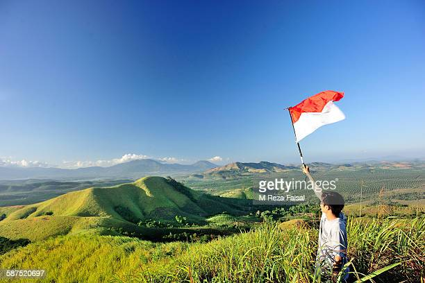 indoesia flag on bukit telang - indonesia flag stock photos and pictures