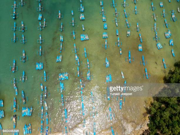 indonesia aerial from above - fisherman boat at tawang beach, pacitan, east java - indonesia - east java province stock photos and pictures